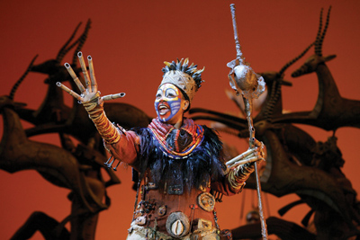 "Phindile Mkhize as ""Rafiki"" in the opening number ""The Circle of Life"" Photo by Joan Marcus"