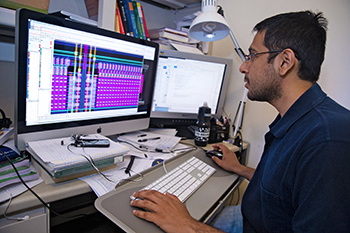 Ph.D. graduate student Siddharth Joshi at work designing a computer chip that mimics brain function.
