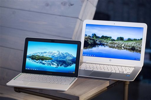 The new HP Chromebook 11, left, is displayed with a Chromebook 14. The new $279 laptop, based on Google's Internet-centric Chrome operating system, borrows many of the high-end features found in a model that costs about $1,000 more. (AP Photo/Mark Lennihan)