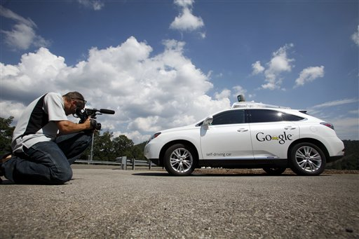 File photo shows a videographer photographing the Google self-driving car at the Virginia Tech Transportation Institute's Smart Road in Blacksburg Va. (AP Photo/The Roanoke Times, Matt Gentry)