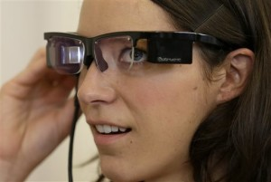 Claire Collins is given a demonstration of Optinvent ORA-S augmented reality glasses. (AP Photo/Jeff Chiu)