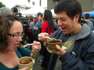Couple sample chili at last year's festival.
