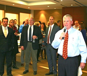 John Morrell, managing partner of Higgs Fletcher & Mack, addresses his staff.