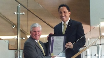 John Morrell, managing partner at Higgs Fletcher & Mack, accepts a proclamation from Interim Mayor Todd Gloria.