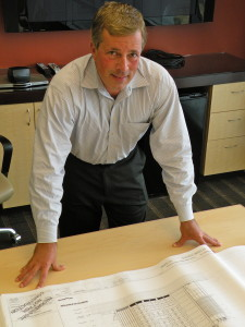 n a 2010 photo, Richard Bach, head of Turner Construction's San Diego operations, is shown with schematics of the Downtown Library.