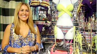 Swimsuit designer Alejandra Boggiano stands next to some of her swimwear at Gone Bananas in Pacific Beach.