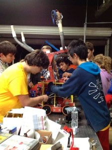 The San Dieguito High School Academy team works on its robot.
