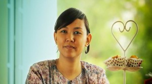 Erin Radzi of Malaysia was able to start a baking business through Qualcomm Inc.'s Wireless Reach program.
