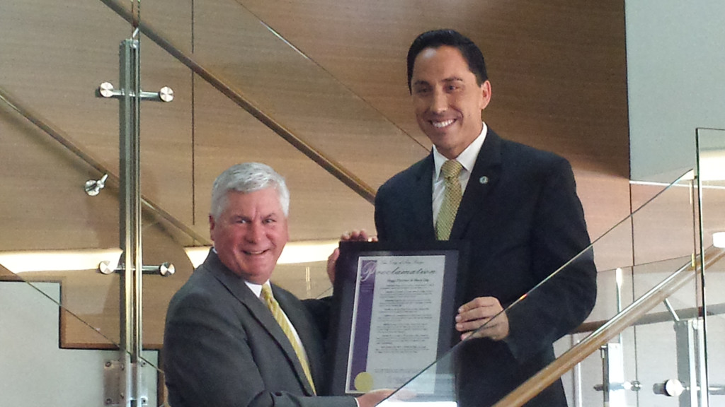 John Morell accepts proclamation from Councilman Todd Gloria honoring the 75th anniversary of Higgs Fletcher & Mack.