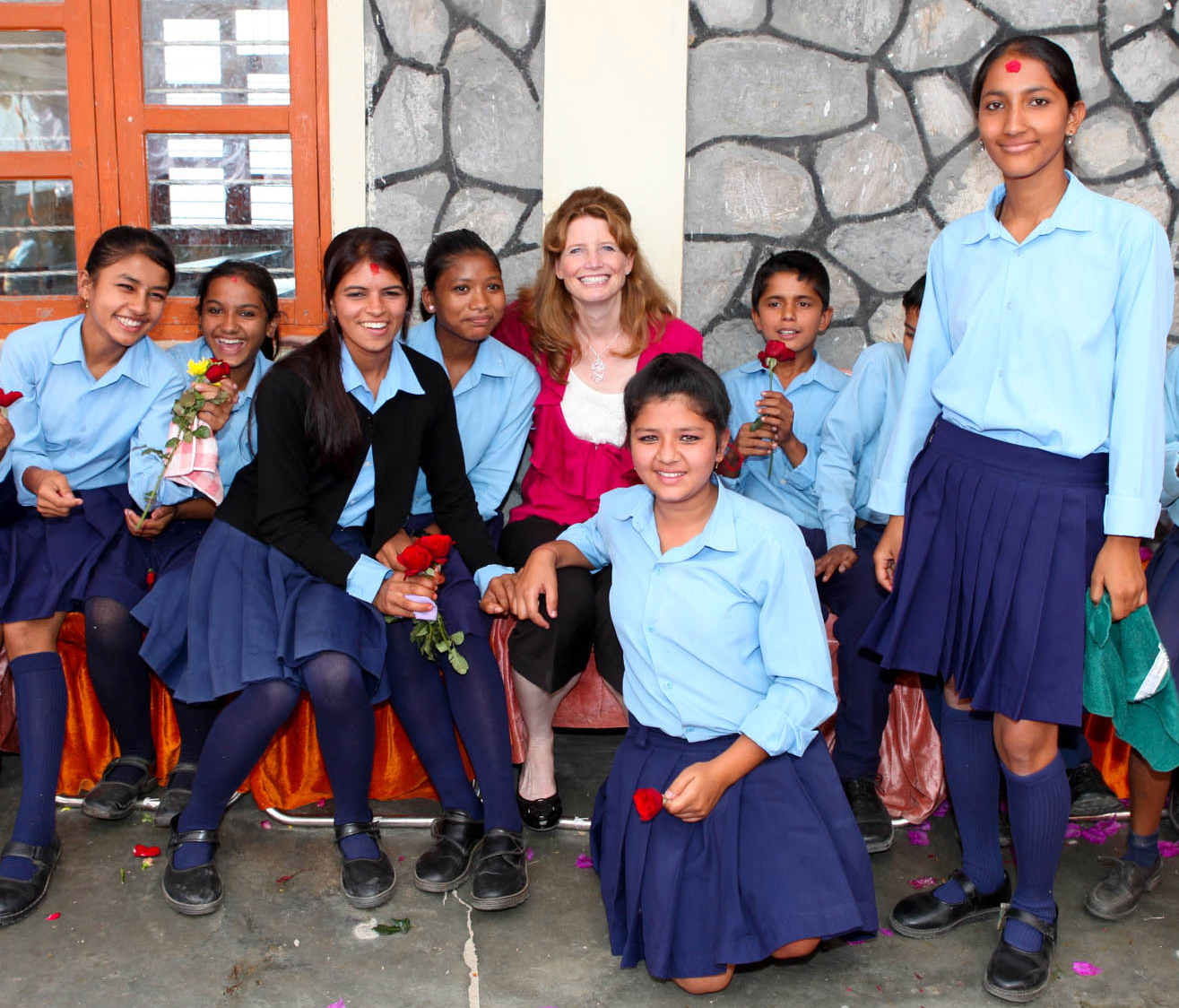 Qualcomm's Shawn Covell with students from a Wireless Reach program in Nepal.