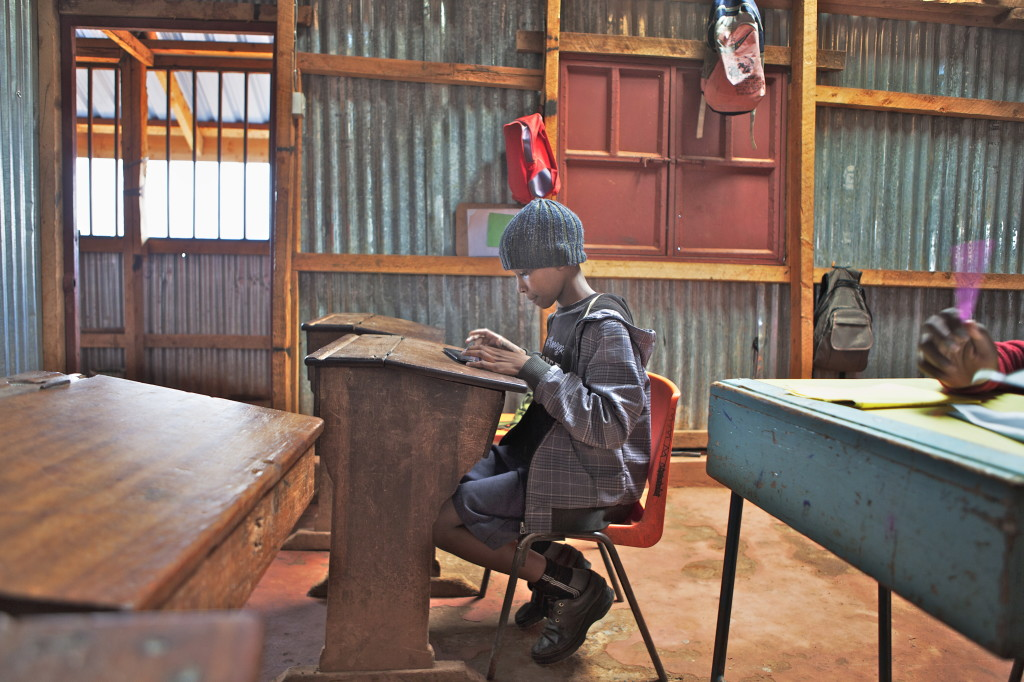 In his classroom, Albert Omwenga Machuk, an 8th grade student in Nairobi, Kenyaworks on a 3G-enabled tablet that has helped him improve his mathematic ranking from No.4 in his class to No. 1.