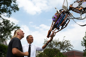 President Barack Obama looks at Lindsay Lawlor's 17-foot-tall robotic giraffe named Russell. (Official White House Photo by Pete Souza)