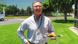 SDG&E project manager Dallas Cormier holds one of the unmanned aircraft. (Photo/courtesy SDG&E)