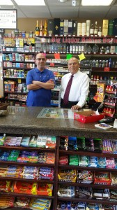 Sabri and son Robert Shamoun behind the counter at OB Quik Stop.