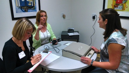 Students and faculty test equipment prior to the clinic's official opening. (Photo/Chris Jennewein