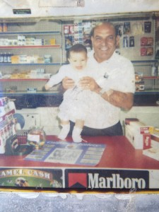 Sabri and baby daughter Larissa in one of his stores. Larissa now works as a staff accountant at RJS LAW.