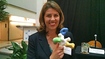 Dr. Erica Ollmann Saphire of the Scripps Research Institute holds a model of the Ebola virus. (Photo by Chris Jennewein)