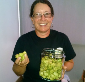 Lyle Kafader, the owner of ZP Growers, with some of the hops she grows in Valley Center. (Photo by Chris Jennewein)