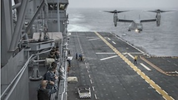 A Marine Corps MV-22 Osprey prepares to land on the flight deck of the USS America. (Navy photo)