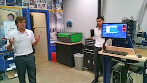 Kyle Kitzmiller (left) and Omar Miyazaki with a laser cutter and CNC router.