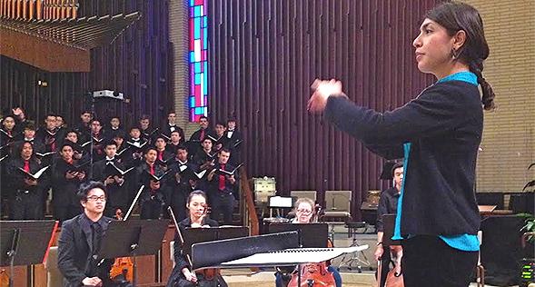 Ibis Betancourt  directs the SDSU Women's Choir.