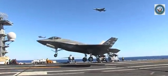 The F-35 settles down on the flight deck of the USS Nimitz.