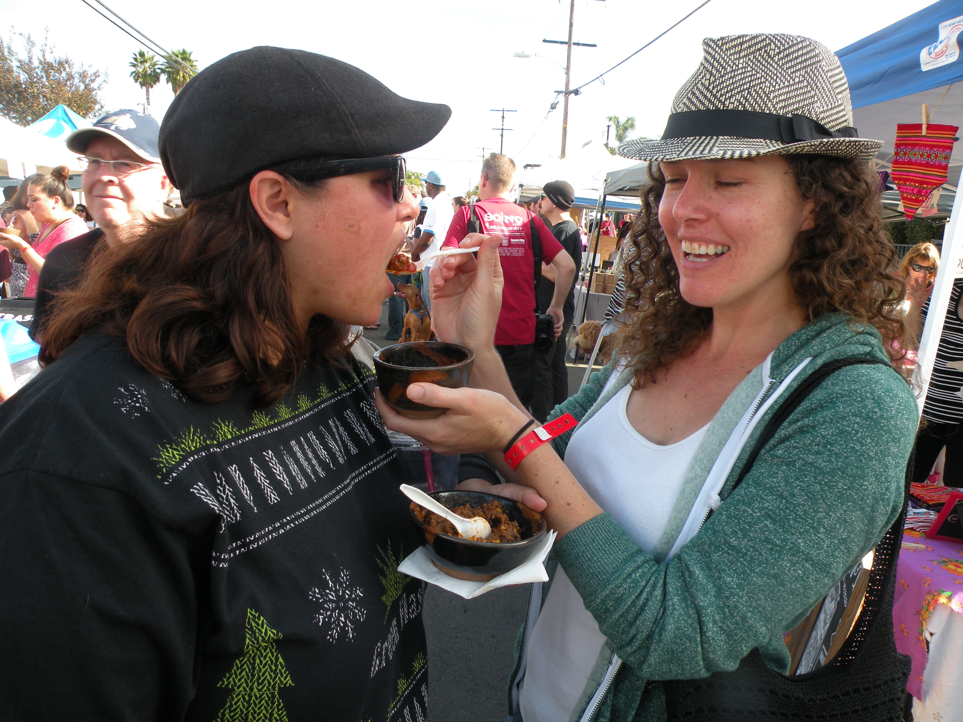A couple of chili tasters at the festival.