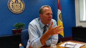 Mayor Kevin Faulconer with the city seal and flag in the background. (Photo by Chris Jennewein)