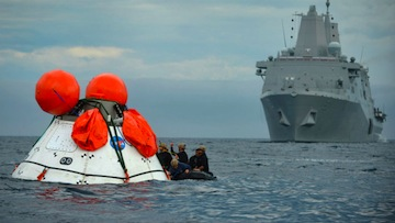 Sailors from the amphibious transport dock ship USS Anchorage and Navy divers participate in a recovery test for the NASA Orion program in September. (Navy photo by Corey Green)