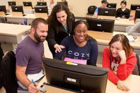 Mesa College Assistant Professor Connie Renda (center) with Health Information Technology students.