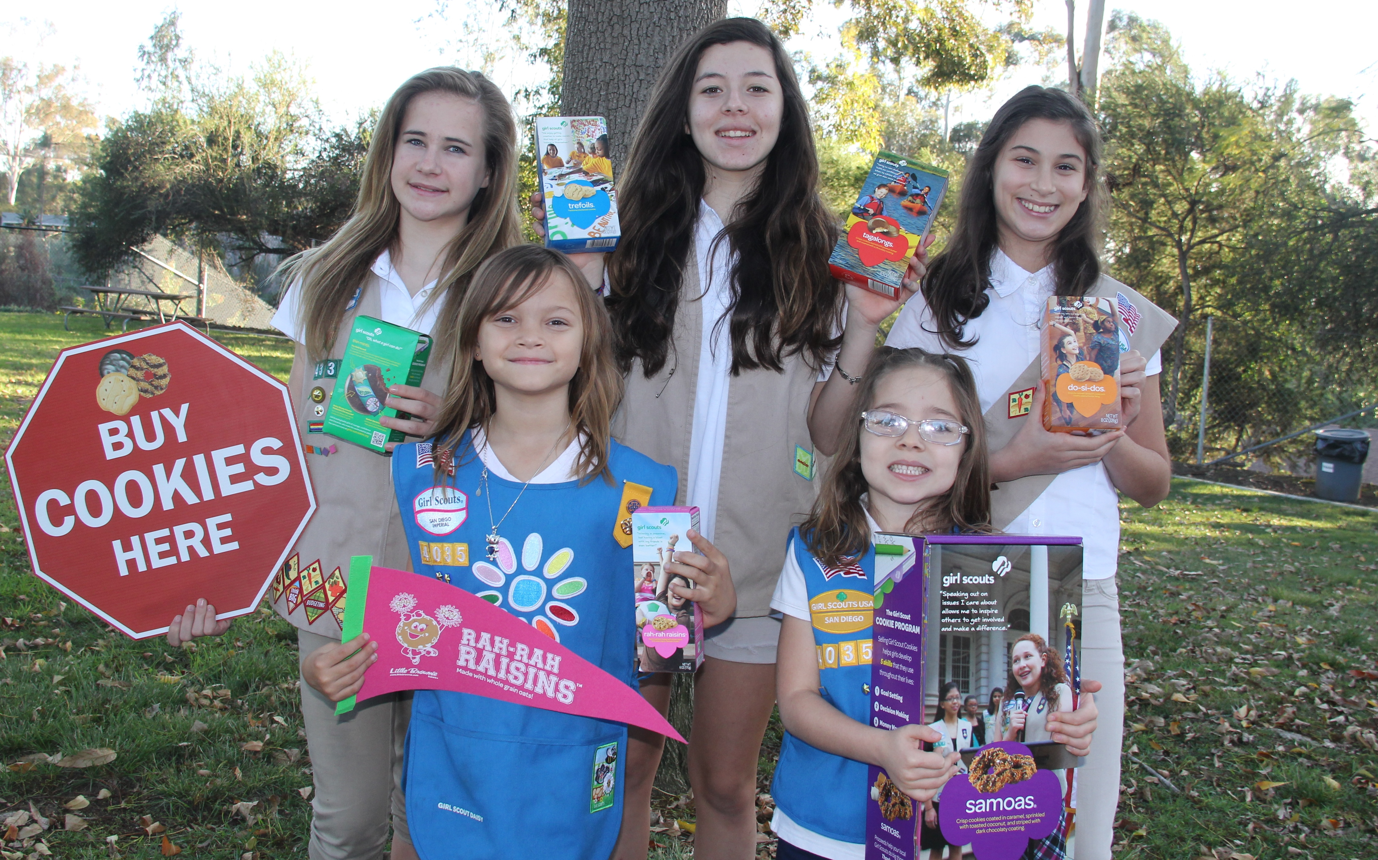 These North Park Girl Scouts stopped by Balboa Park headquarters to pick up cookie marketing supplies. Back row, from left: Girl Scout Cadettes Molly, Abril and Reneé of Troop 4339; front: Girl Scout Daisies Kaia and Maya of Troop 4035. Maya's oversized box of Samoas touts the chocolate-coconut-caramel cookie's 40th anniversary.