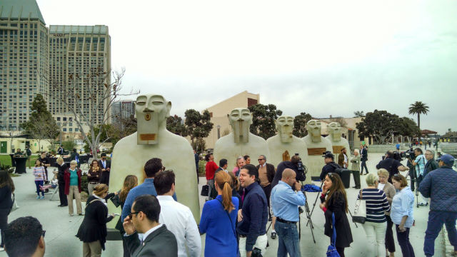 Crowds surround five of the bronze sculptures after the unveiling. Photo by Chris Jennewein