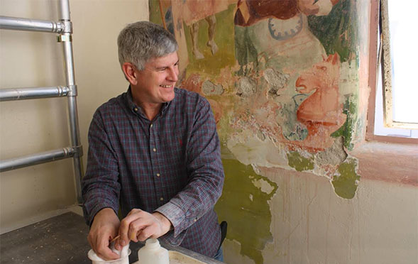 Gary Hulbert, a conservator, working on the mural.