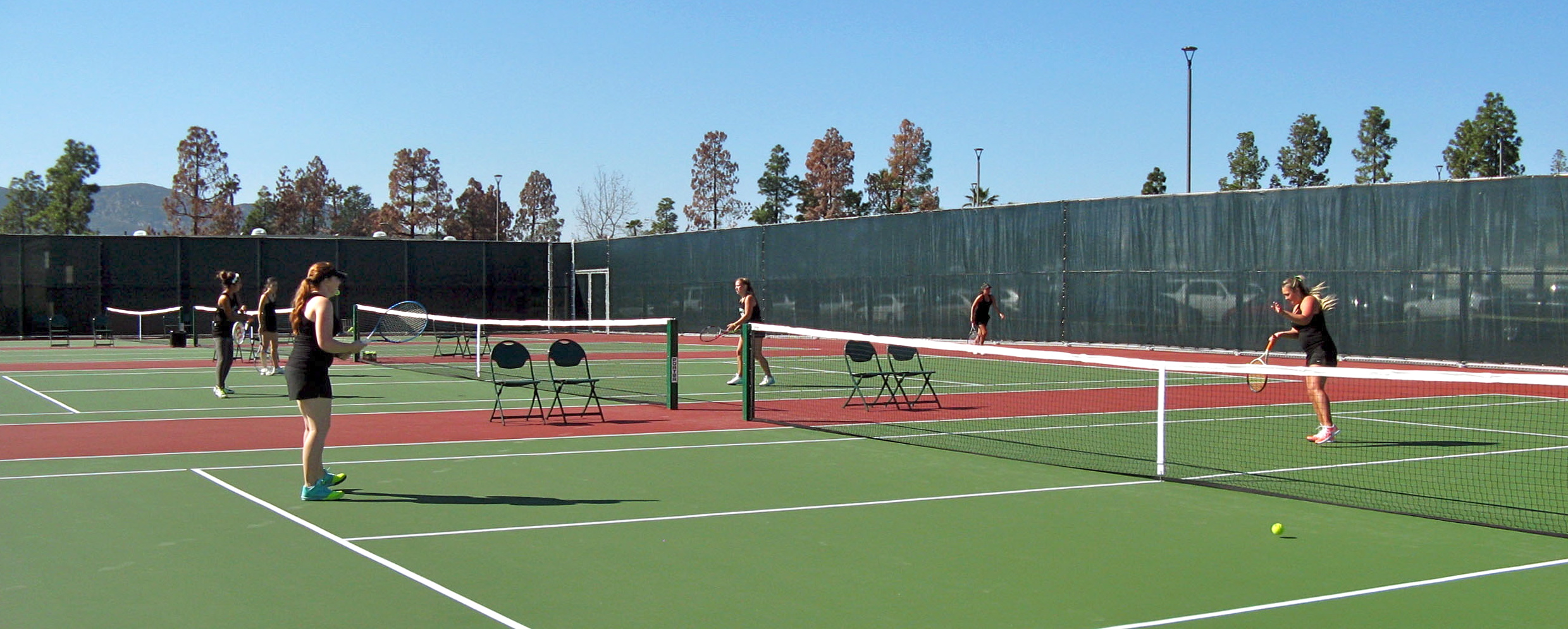 Members of the women's tennis team at Grossmont College play on the new tennis courts.