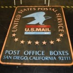 Carved wood USPS sign