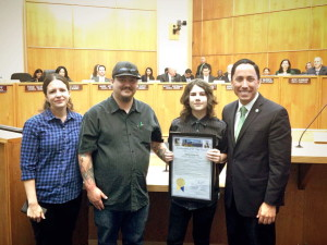 Nathan Odom holds proclamation, joined by his parents and Councilman Todd Gloria.