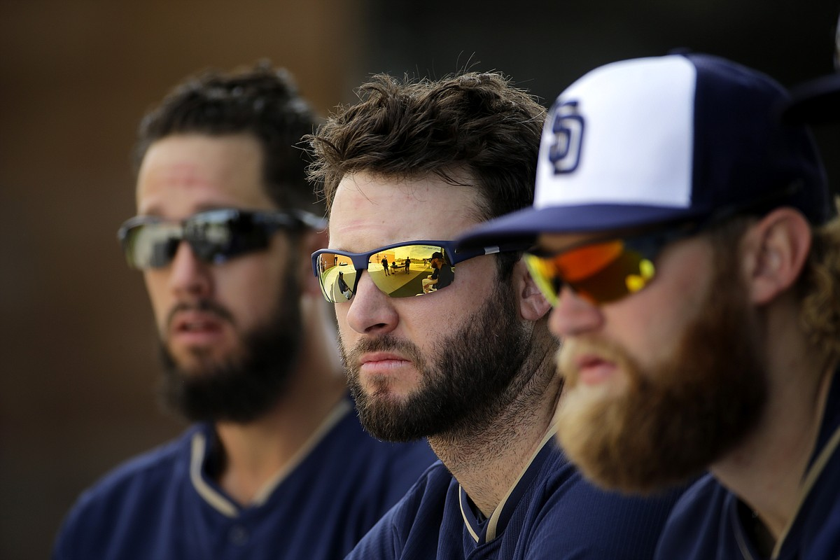 San Diego Padres pitchers James Shields, left, Brandon Morrow, center, and Andrew Cashner listen to instructions during spring training baseball practice Saturday, Feb. 21, 2015. (Associated Press)