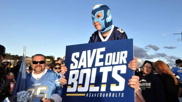 Young Chargers fan carries sign at Monday rally.