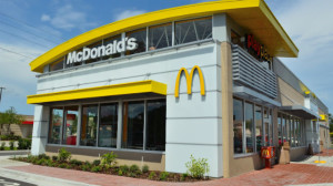 McDonald's officials said about 10 percent of the restaurants in the country are company-owned, and the new benefits will affect about 90,000 employees.