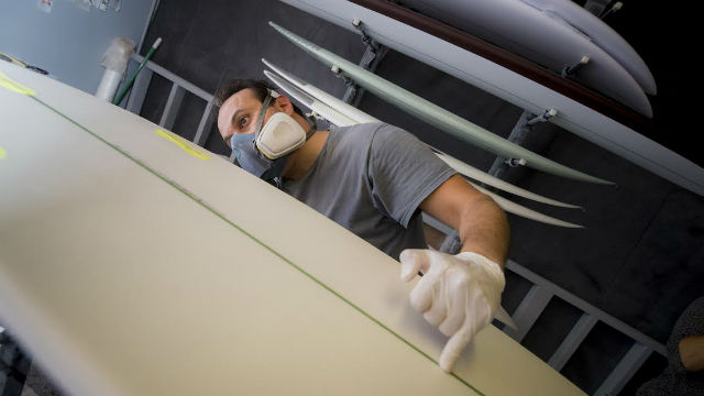 Shaping the algae surfboard created by UC San Diego.