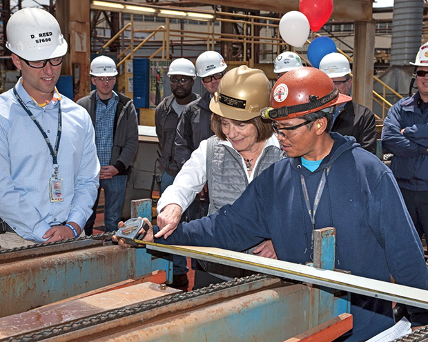 Congresswoman Susan Davis measures the first piece of steel for the fourth American Petroleum Tanker.