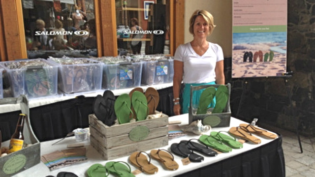 Terri Kelly stands with her products on display.