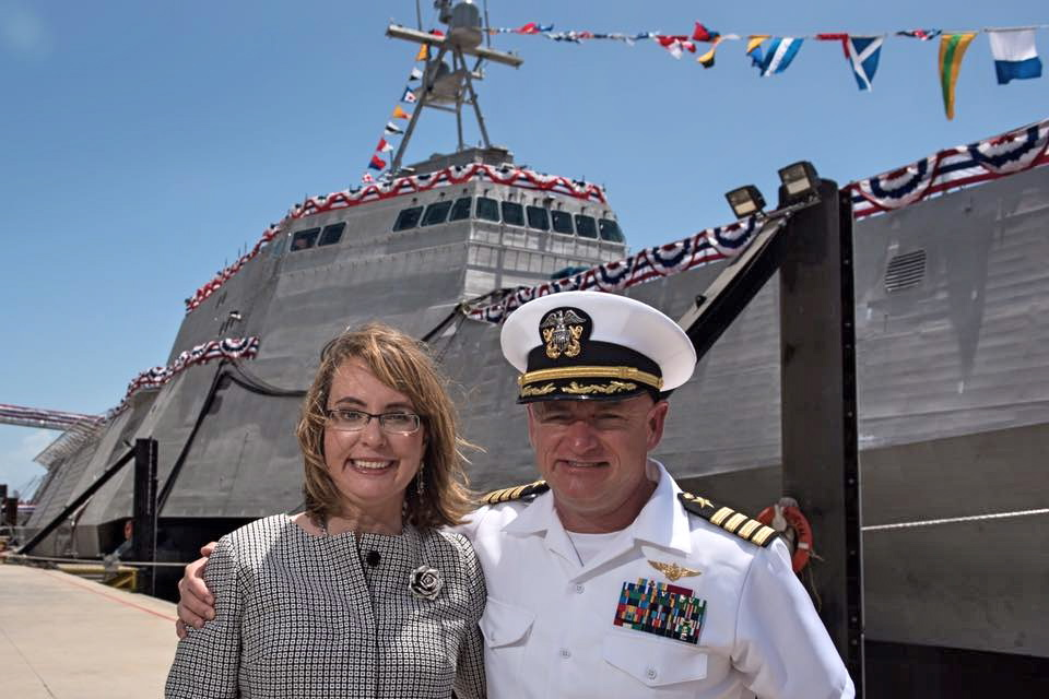 Gabby Giffords with her husband, Navy Captain and NASA astronaut Mark E. Kelly at the christening.