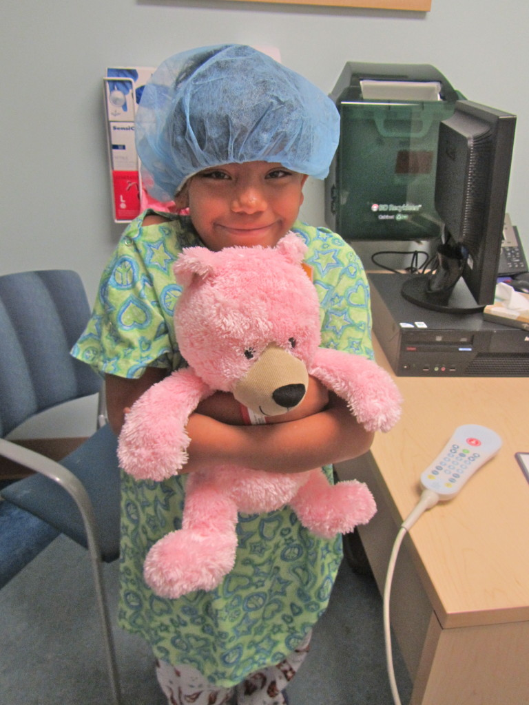 A young patient can't be without her teddy bear.