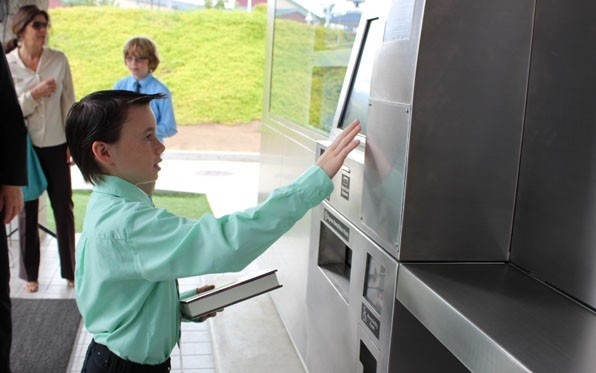 A 24/7 Library-to-Go kiosk measures 8 feet tall, 13 feet wide and 5 feet deep or about the size of a bus shelter and operates like a vending machine.