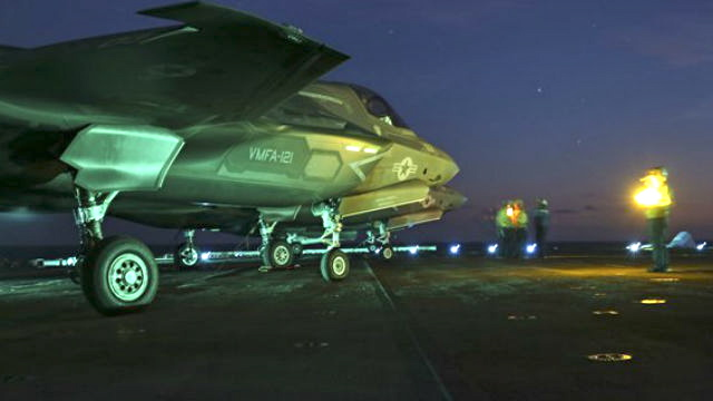 An F-35B prepares to taxi on the flight deck of the USS Wasp during night operations at sea as part of the first squadron's operational test in May. (Marine Corps photo)