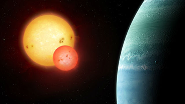 Artist's impression of the Kepler-453 system showing the newly discovered planet on the right and the eclipsing binary stars on the left. Illustration copyright Mark Garlick