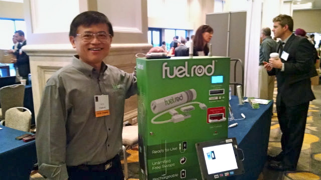 Chi Yau with a Fuel Rod kiosk for exchanging cell phone batteries. (Photo by Chris Jennewein)