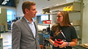 Rep. Eric Swalwell with UC San Diego student Elyce Bayat, who is holding a rocket engine. (Photo by Chris Jennewein)