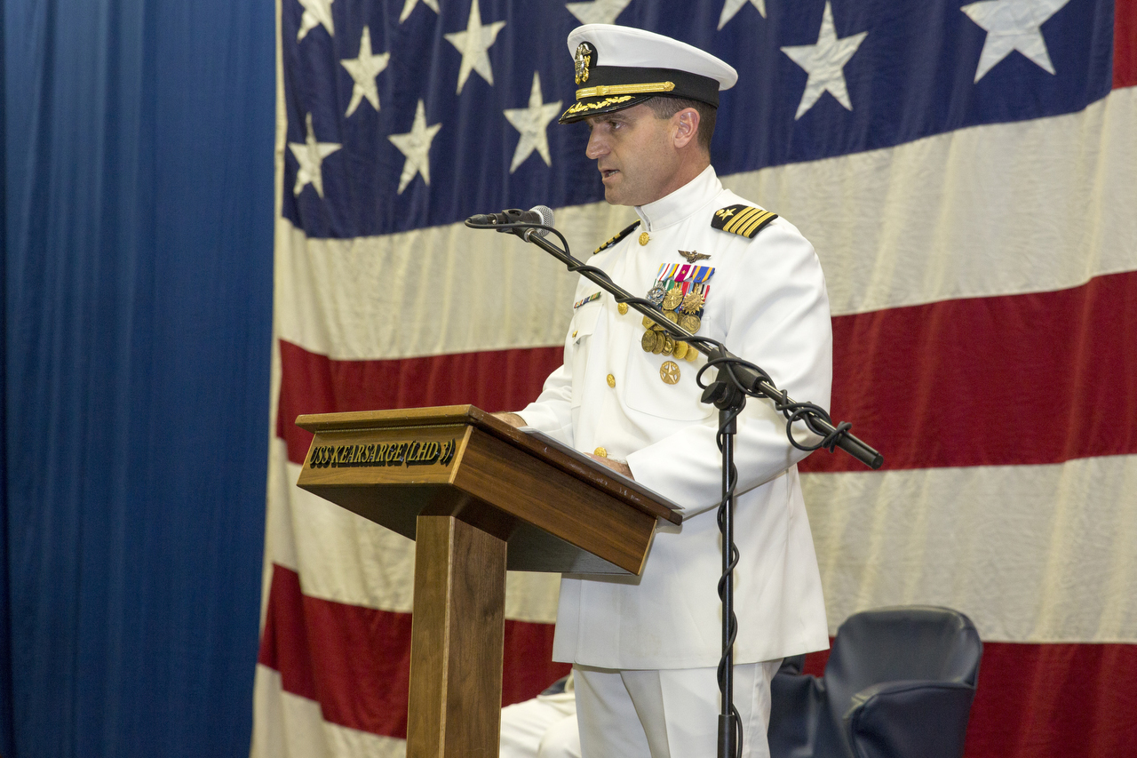 Capt. Larry Getz speaks during a change of command ceremony onboard the amphibious assault ship USS Kearsarge. During the ceremony, Getz relieved Capt. David L. Bossert, becoming the ship's 16th commanding officer. (U.S. Navy photo by Mass Communication Specialist 1st Class ChaRunge)